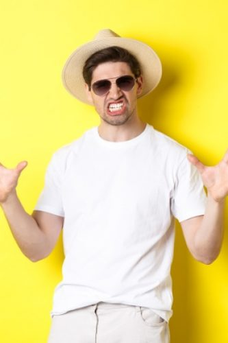 tourism-travelling-holidays-concept-sassy-young-man-vacation-showing-something-big-clenching-teeth-standing-sunglasses-summer-hat_1258-40964